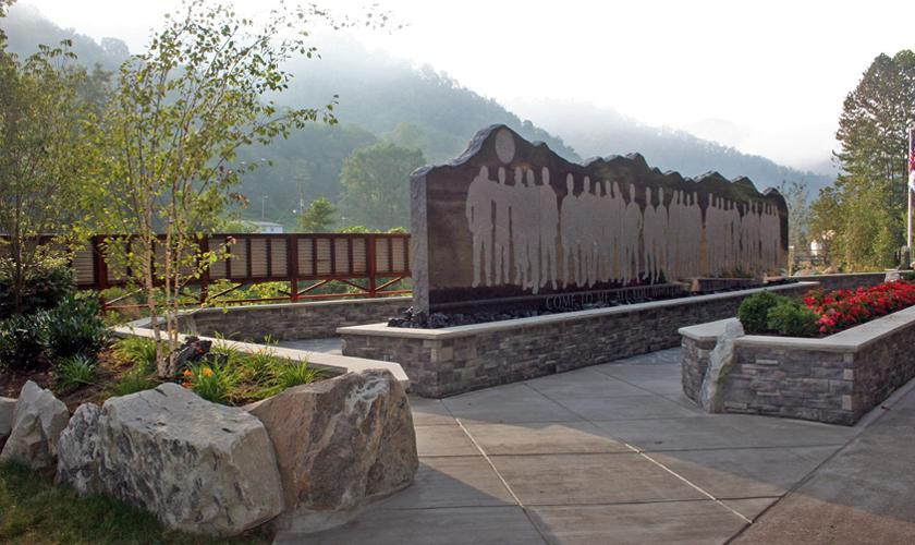 The back of the Upper Big Branch Miners Memorial is etched with the miner tributes and the history of mining in West Virginia. Other smaller tributes and memorials are located within the memorial park.